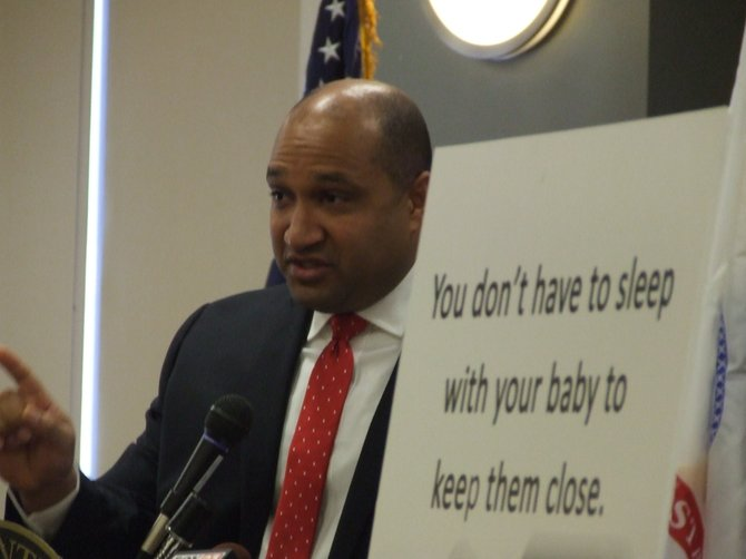 "Albany County District Attorney David Soares helps announce the launch of the ""Safe Sleeping"" campaign to educate the public on preventing infant deaths."