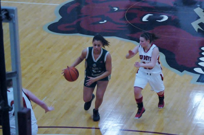 Angel Barnes of Elizabethtown-Lewis drives to the basket against Courtney Bova of Hammond.