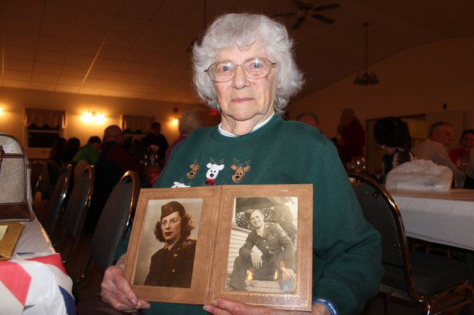 Dorothy LeClair, an Army nurse during World War II, holds a photo of herself, left, and her husband, Carl LeClair, who served in the Army during World War II. North Country Honor Flights is transporting local veterans to Washington, D.C. to visit the World War II memorial there.