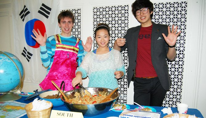 Grace Sturgus, Seokjaw Hong, and Harry Joannette serve traditional South Korean food to guests at International Night on Feb. 28 at Keene Central School.