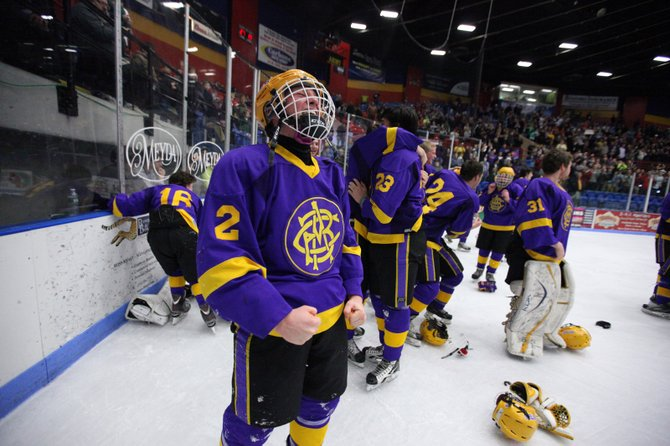 CBA/Jamesville-DeWitt ice hockey player Grayson Burns (2) shouts amid the celebration of his team's first-ever state Division II championship, earned Sunday with a 4-2 victory over John Jay-Cross River at Utica Memorial Auditorium.