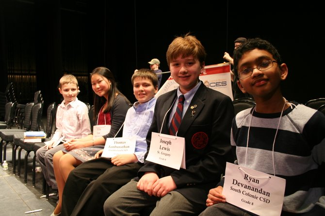 Ryan Devanandan (far right), an eighth grader at Sand Creek Middle School, won the 2013 Capital Region spelling Bee on Tuesday, March 5.