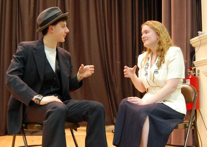 Sam Balzac as the lead Sky Masterson and Cassandra Day as the leading lady Sarah Brown act out a scene of Guys and Dolls at Keene Central School on March 7. The play will be held on March 22 and 23.