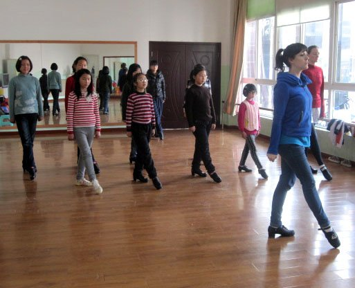Jesse Hoselton, of Skaneateles, leading an Irish dance class in China. Hoselton has been teaching English in a Chinese school for almost two years, but has also helped to teach Irish dancing a skill she learned while living in Skaneateles.