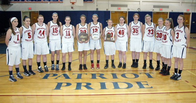 The Section VII/Class C and Region II Class C champion AuSable Valley Patriots. From left: Meghan Strong, Taylor Saltus, Bryce Douglass, Madison Rondeau, Logan Snow, Sierra Snow, Haley Taylor, Vanessa Garrow, Nicole SantaMaria, Shelby Bourgeois, Sydney Snow, Madison McCabe, Jeanna Manning and Rachel Knapp.