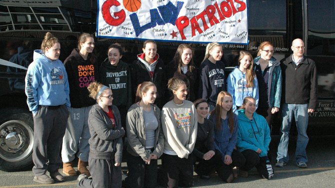 Members of the AuSable Valley girls basketball team pose for pictures as students and community members turned out for a Final Four sendoff March 15.