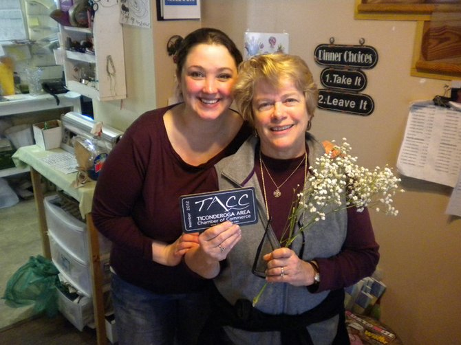 Portia Burke and Francine Burke from The Country Florist & Gifts receive their 2012 chamber plaque during last year's Chamber Day. The third annual event will be Tuesday, April 2.