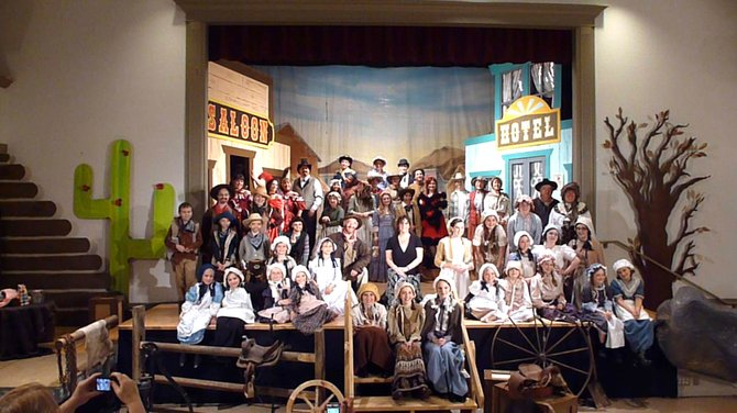 "Elyse Young produces two musicals a year, including ""Wagon Wheels West"" pictured here, with the Spotlighter's Theatre Troupe at the Malta Community Center."