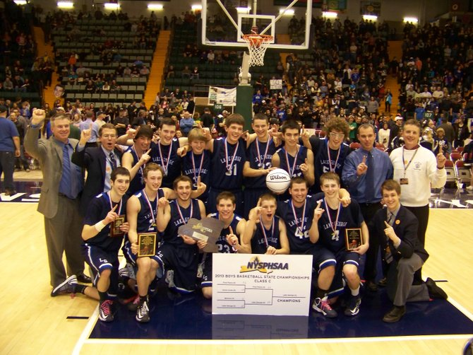 The Lake George Boys Basketball team celebrates minutes after they won the New York State Class C Basketball Championship. Despite a substantial height deficit, the Warriors beat Pine Plains 55 to 45 in the finals Saturday March 16 by following through on their cklever game plan, pursing an aggressive defense that forced a lot of turnovers  and with incredible determination and heart.