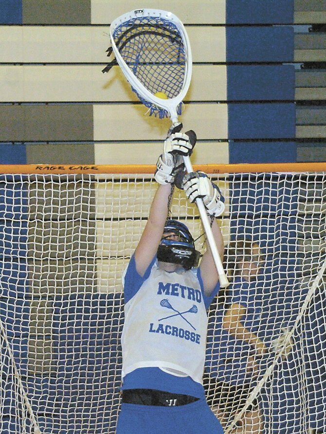 Shaker goaltender Julia Maloney makes a save during an indoor practice last Wednesday. Maloney takes over for Anne Morrison between the pipes for the defending Section II Division I champs.