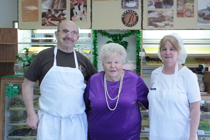 From left, Jerry and Joan Rambach, and Rambach's Bakery's new owner April Brown.