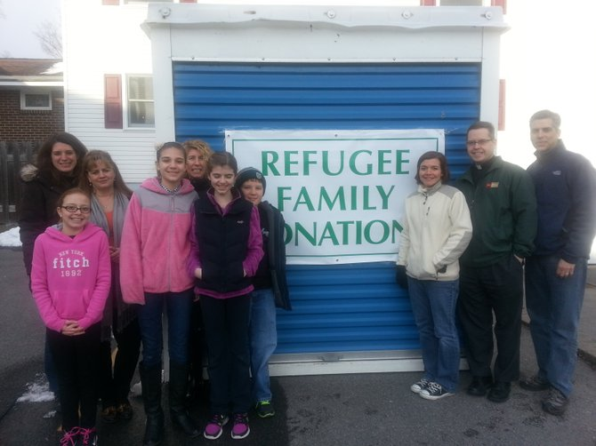 Members of the refugee project committee and their families are collecting furnishings for an apartment to house a refugee family on Syracuse's North Side.