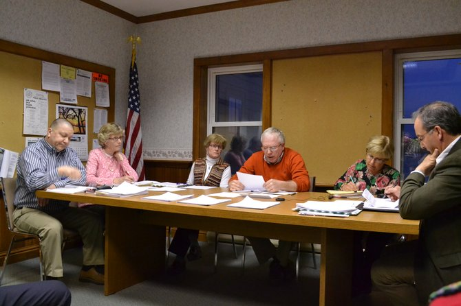 The current village board which will be together for the next two years. FROM LEFT: trustees Jim Lanning, Mary Sennett, Sue Jones, mayor Marty Hubbard, village clerk Patty Couch and trustee Marc Angelillo.