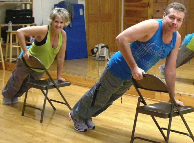 Cory Sawyer and Jim Scholefield teaching Zumba Sentao, a chair-based style.