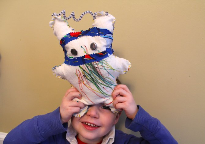 "Declan O'Hegarty, 3, with his plush creation ""Space Bunny."""