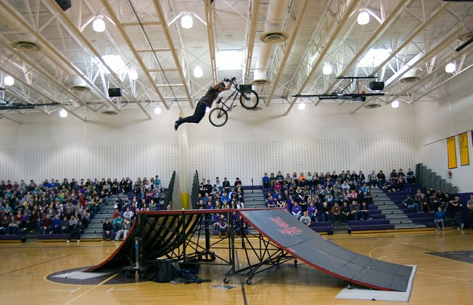The Rise Above BMX team entertain Voorheesville High School students by performing various tricks in the gymnasium during the district's Wellness Day on Thursday, March 21.