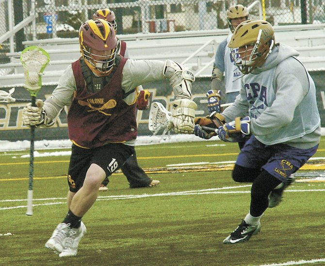 Colonie's Mike Mineau, left, goes past a Christian Brothers Academy player during last week's scrimmage at The College of Saint Rose.