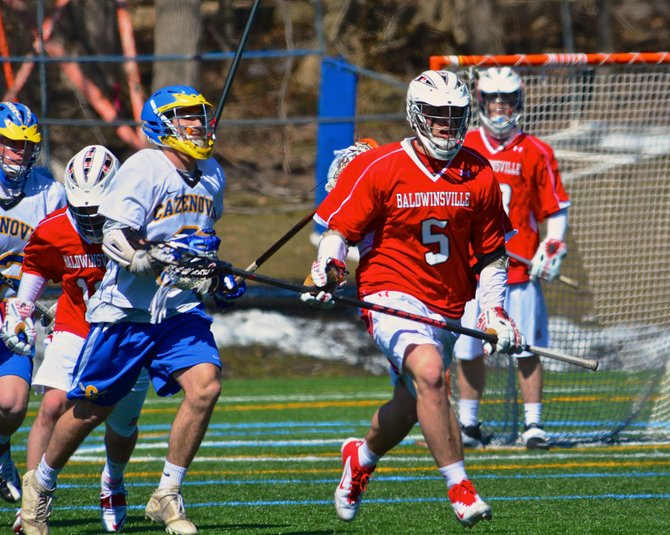 Baldwinsville defender John Walker (5) forces a turnover and then runs upfield with the ball in Saturday's game against Cazenovia. Despite a strong effort from the Bees' defense, it still lost 5-4 in overtime to the Lakers in a contest played on the turf at Cazenovia College.