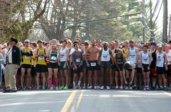 Runners lined up at the starting line at the 2011 Delmar Dash. This year, the event is celebrating its 25th anniversary.