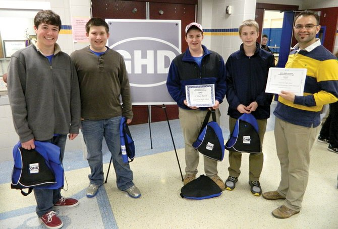 """""""The Squad"""" team members, from left, Peter DeCew, Brendan Wells, Carl Bauder and Frank Marconi, along with their technology teacher and challenge advisor Jason Hyatt, pose with their awards."""