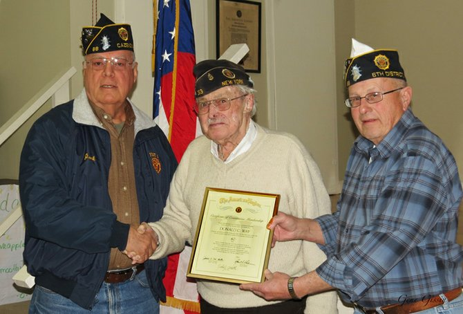 Don Way, center, receiving a certificate for his 60 years of membership in the American Legion from Jack Mott, commander of the Cazenovia American Legion Post 88, left, and Joe Barrilla, vice commander of Post 88.