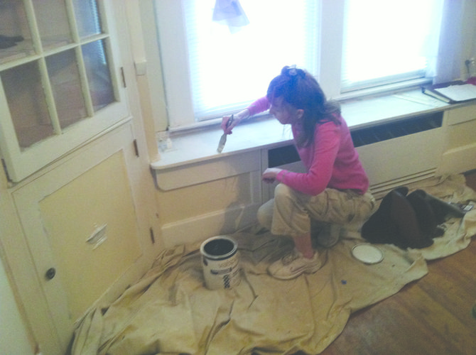 Bostick transforms an ugly, old room with new paint, as will be done in the Women's Center's waiting spaces with students.