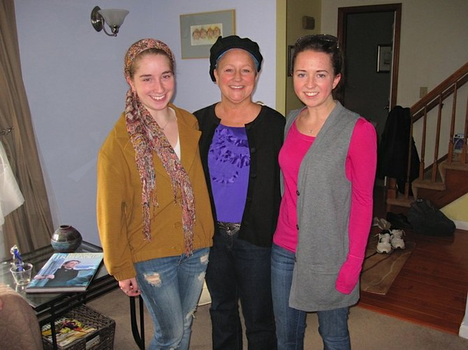 Jean Bassett (middle) with her two daughters, Elena (left) and Amanda (right). Jean died on Easter morning after battling breast and brain cancer for three and half years.