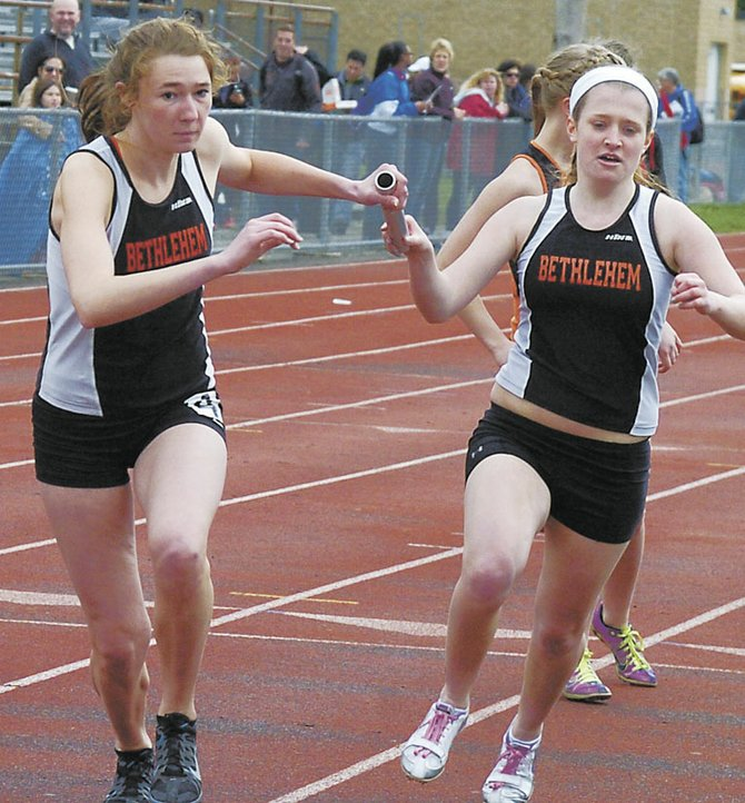 Bethlehem's Tori Trosset, right, hands the baton to Danika Jensen during the varsity sprint medley relay at Saturday's Fleet Feet Lady Eagles Invitational.