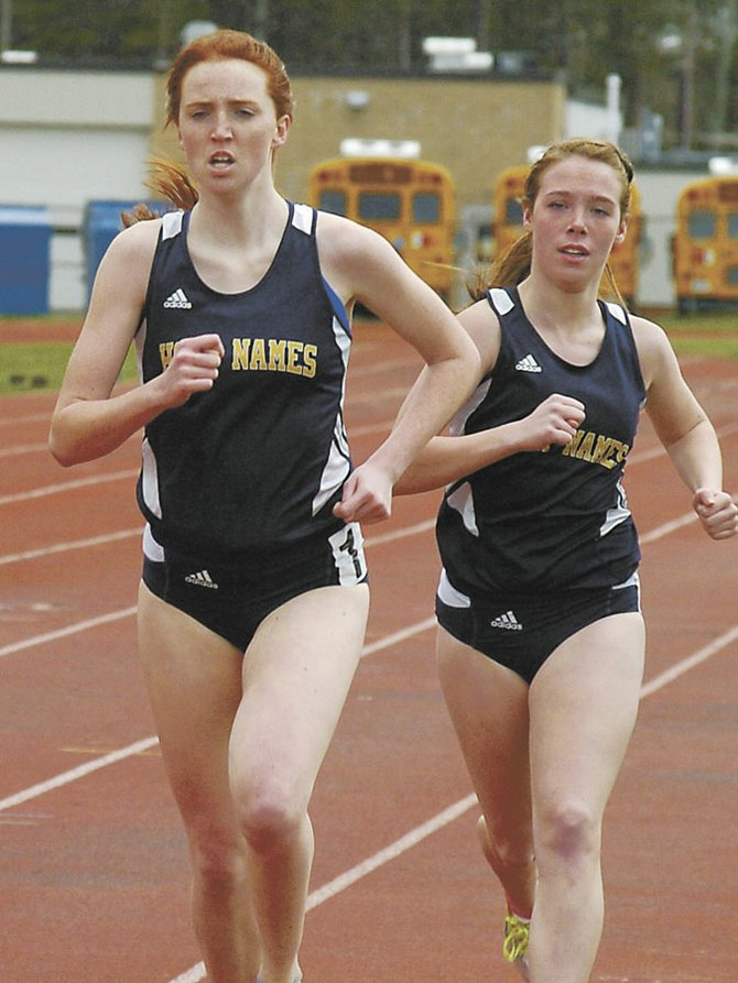 Kaylee Scott, right, keeps Loudonville native Catherine Maloy company through the second lap of the 1,500-meter race at Saturday's Fleet Feet Lady Eagles Invitational at Bethlehem Central High School. Maloy pulled away from her Holy Names teammate to win the race.
