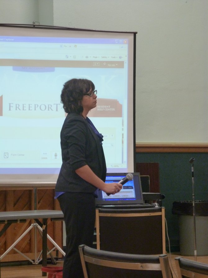 Nicole Kibodeaux, of web design firm Civic Plus, presents options for the town's new website design to Town Board members.
