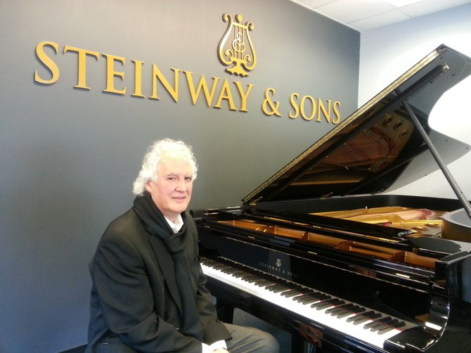 Frank DeFonda sits at a Steinway model D piano in the store, which is Steinway's most expensive piano at about $150,000.