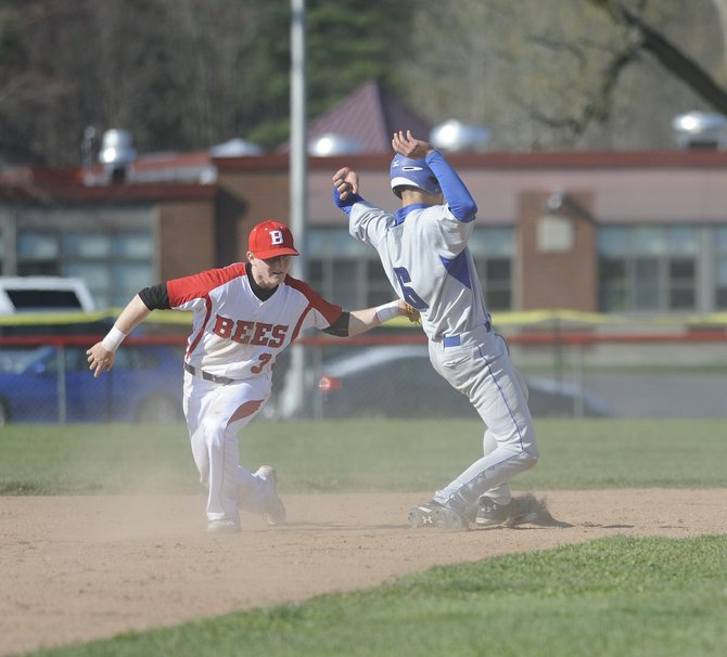 Cicero-North Syracuse catcher Justin Teague (6) slides into second base, ahead of the tag of Baldwinsville's Josh Savacool (3), in Thursday afternoon's clash of Class AA state-ranked teams, where the no. 9 Northstars defeated the no. 14 Bees 10-4.