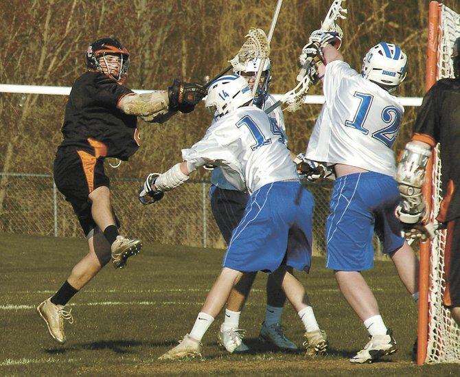 Bethlehem's Joe Verstandig, left, shoots against the Shaker defense during an April 26 Suburban Council game in Latham.