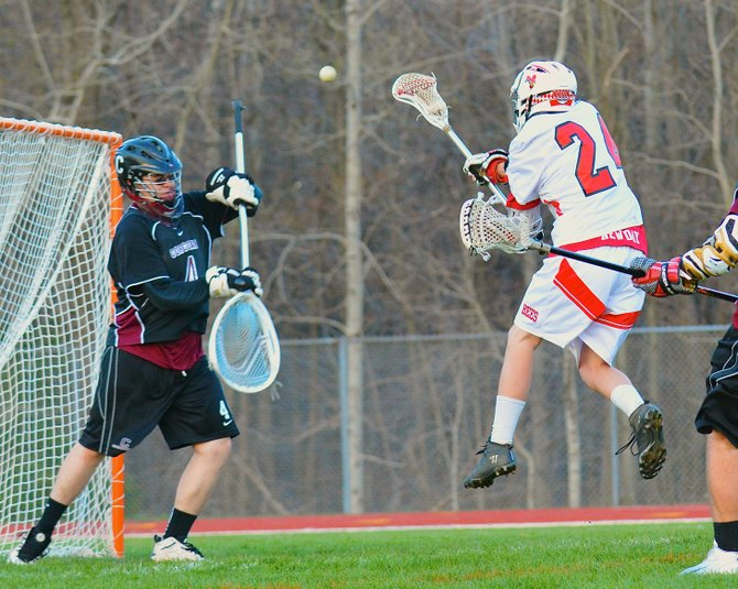 Baldwinsville midfielder Sean Barron (24) jumps and fires a shot past Corcoran goalie Noah Galvan in last Thursday night's game at Pelcher-Arcaro Stadium. Barron added an assist as the Bees rolled past the Cougars 10-1.