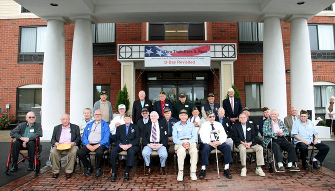 Veterans at the 2012 D-Day Revisited Recognition and Remembrance event pose for a photo. This year's event will be held on Saturday, June 1, at the Holiday Inn Express located on Old Loudon Road in Latham.