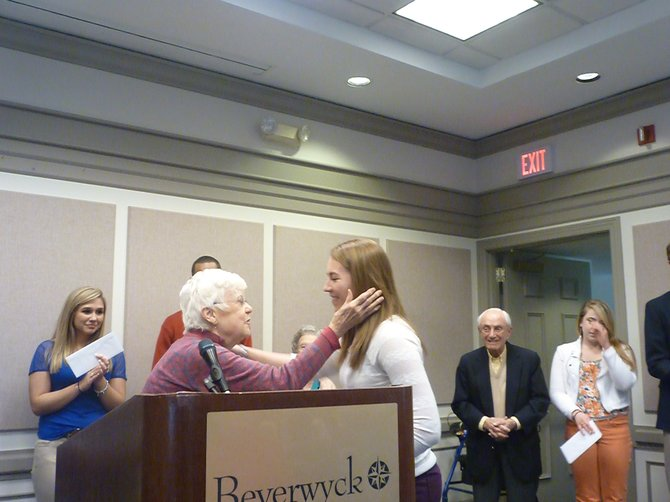 Members of the scholarship committee at the Beverwyck Retirement Community present awards to recipients, who also work as employees in the facility's dining area.