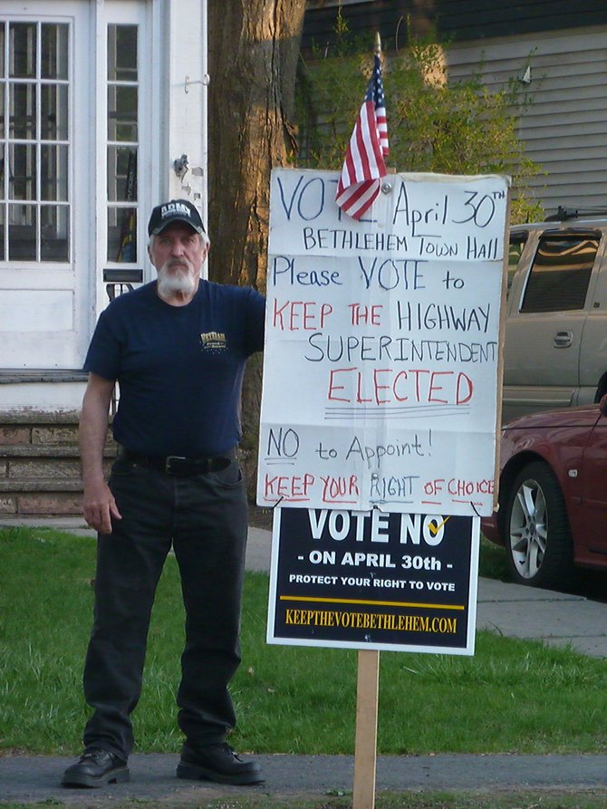 A Bethlehem resident urges voters to vote against the highway referendum across the street from Town Hall on Tuesday, April 30.