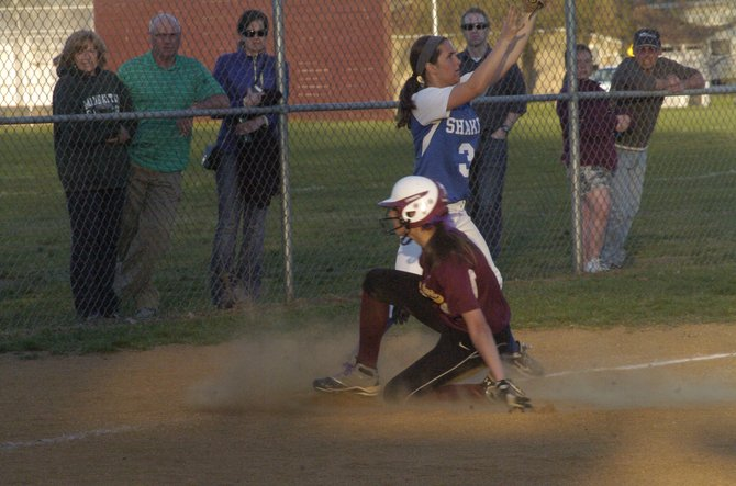 Colonie's Sam Blum slides safely into third base after hitting an RBI triple in the first inning of Wednesday night's Suburban Council game against crosstown rival Shaker.