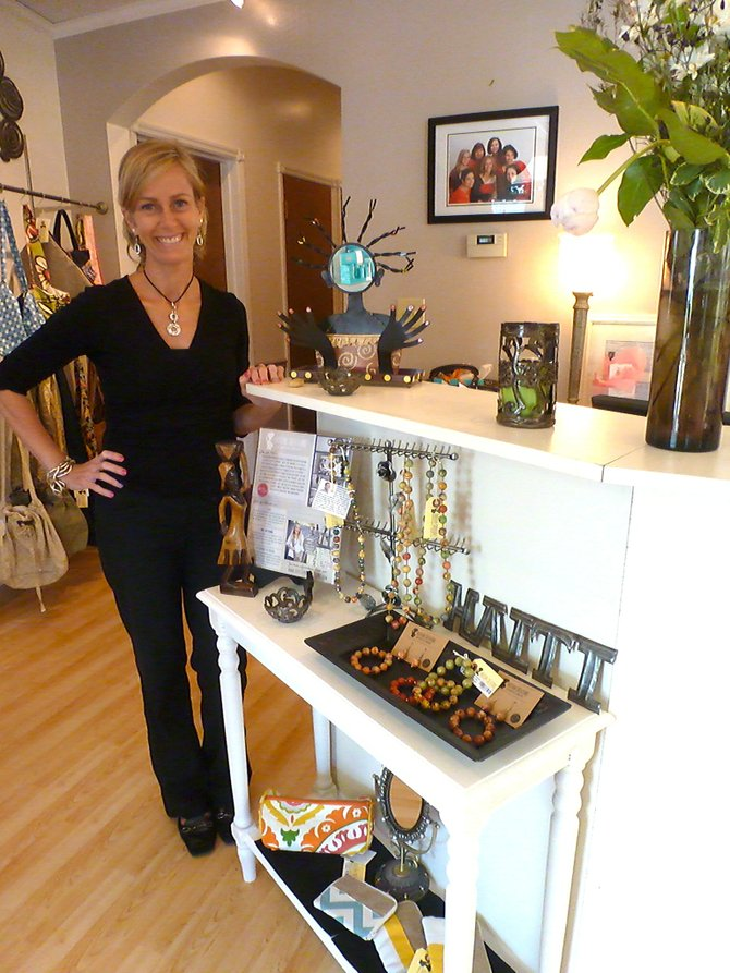 Sherry West, owner of Day Dreams of Delmar Day Spa and Salon, with a selection of Haitian Creation products.