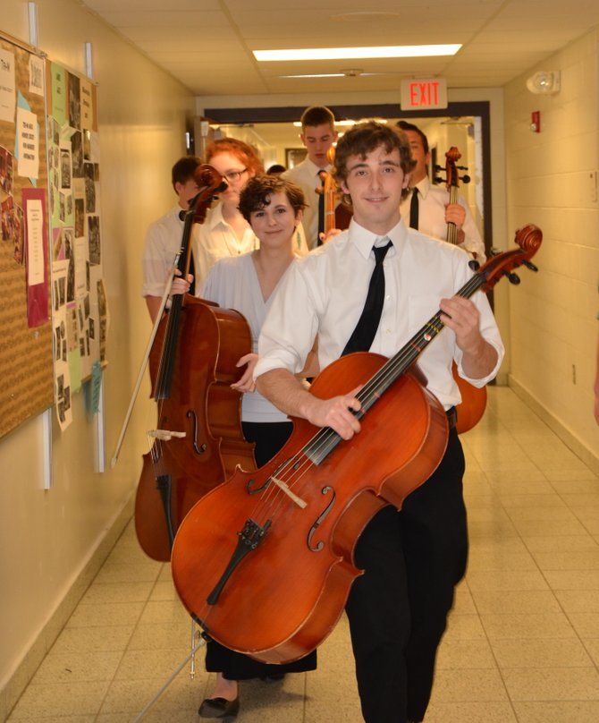 Skaneateles orchestra students head down the hallway toward the auditorium for their performance in front of judges.