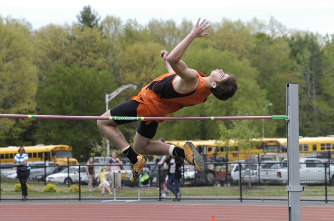 Bethlehem's Drew Duguid clears the bar at 6 feet, 1 inch to win the high jump title at Friday's Suburban Council Boys Track and Field Championships at Shenendehowa High School.