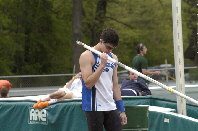 Shaker's James Steck readies himself for his first attempt in the pole vault at Friday's Suburban Council Boys Track and Field Championships at Shenendehowa High School. Steck won the title by clearing the bar at 14 feet, 6 inches.