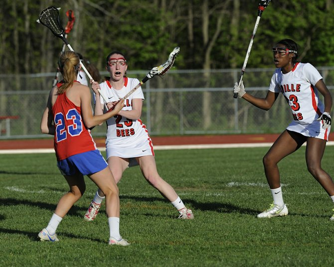 Baldwinsville girls lacrosse teammates Amanda Klein (23) and Amari Pollard (33) line up to stop a possible attack in last Monday's game against Fairport. The Bees' defense would shut out Fairport in the second half of an 8-3 win and go on to beat Liverpool a night later before a late-week defeat to Cicero-North Syracuse.