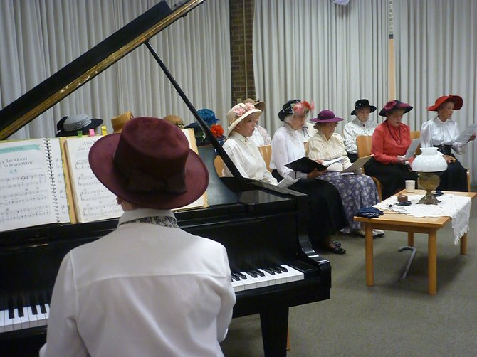 Members of the Delmar Progress Club reenact the founding meeting of the Bethlehem Public Library in 1913, along with songs sang at several concert fundraisers.