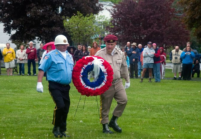 A wreath is placed next to the American flag in Orsini Park in honor of those who paid the ultimate sacrifice during Altamont's Memorial Day Ceremony on Sunday, May 19, following the parade.
