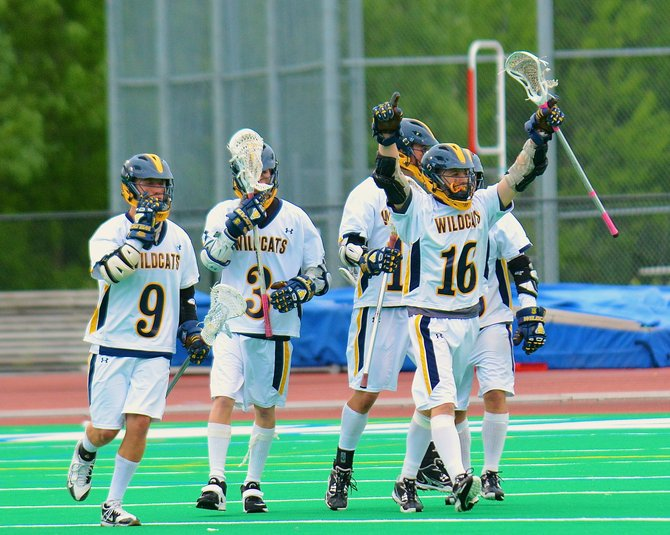 West Genesee attacker Brady Hoose (16) celebrates, with his teammates, the goal with 3.1 seconds left that gave the Wildcats a 9-8 victory over Baldwinsville in Friday's Section III Class A semifinal. The Wildcats will face Fayetteville-Manlius in next Tuesday's title game at the Carrier Dome.