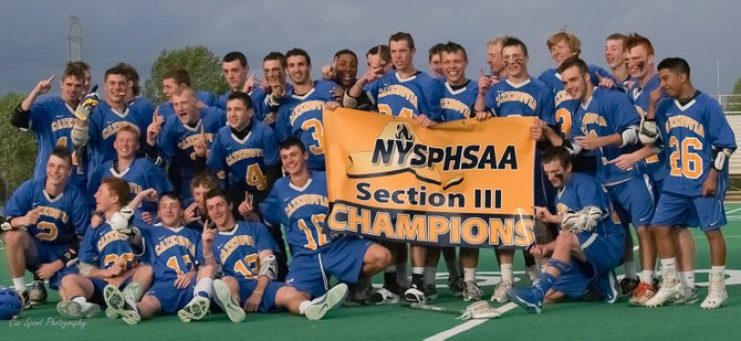 The Cazenovia boys lacrosse team celebrates with the Section III Class C championship banner after defeating LaFayette, 15-9, in Saturday's sectional final at Cicero-North Syracuse's Bragman Stadium. The Lakers, in the last two rounds of the sectional tournament, avenged both of its regular-season defeats - first to Westhill, and then to LaFayette.