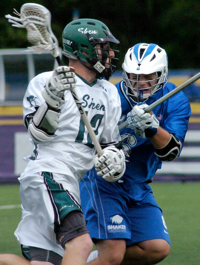 Shaker's Kyle Fragnoli, right, defends Shenendehowa's Brian Rogers during Saturday's Section II Class A championship game at the University at Albany.