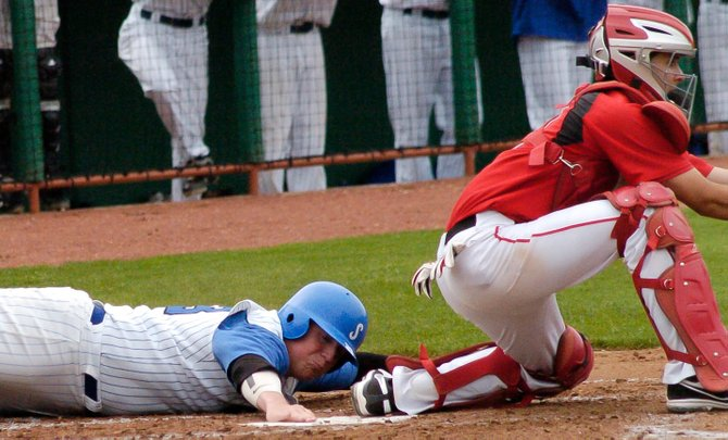 Shaker's Tyler Hoffman slides safely across home plate for the Blue Bison's second run in a 7-3 victory over Guilderland in Tuesday's Section II Class AA semifinal game at Joseph Bruno Stadium.