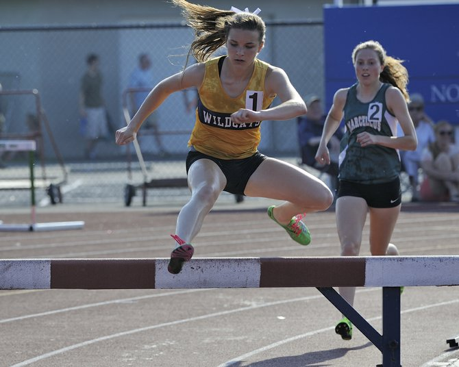 West Genesee's Laura Leff, foreground, and Marcellus' Rachel Garn head over a hurdle in the 2,000-meter steeplechase during Thursday's Section III state qualifier. Both of them won their respective divisions and advance to next weekend's state meet at Middletown.